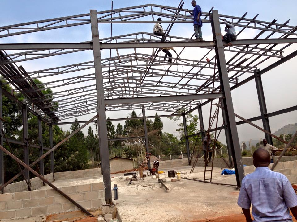 Fitting the purlins to hold the roofing sheets-warehouse