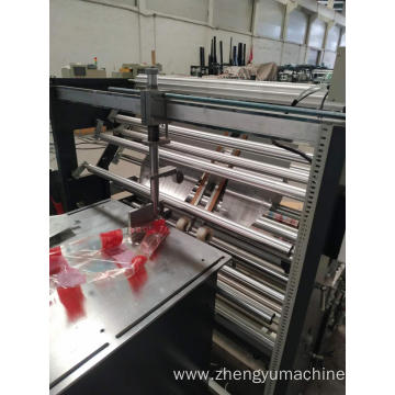 Center seal plastic pouch making machine