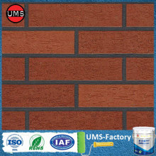 Brick red wall texture effect with paint