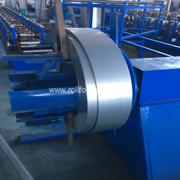 Roll forming machine for standing seam roof panels
