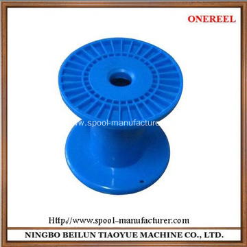 small empty plastic spools
