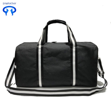 Black and white striped canvas travel bags