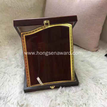 red wooden plaque with wooden box
