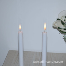 Taper white candles for religion and decoration