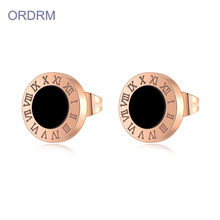 Small rose gold roman numeral stud earrings