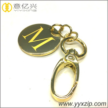 Polished gold later logo metal label keyring