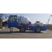 Mobile self-loading concrete mixer truck