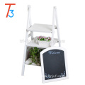 white freestanding wooden chalkboard easel with 3 display shelves