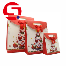 Brown paper Christmas gift bags with handles