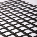 Fiberglass geogrid reinforced composite nonwoven geotextile