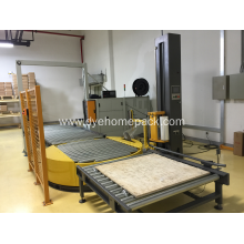 Unmanned pallet wrapping machine with powered conveyor