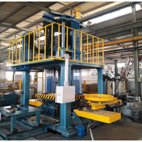 Small footprint low pressure die casting machine