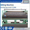 Slitting and rewinding machine with razor knife