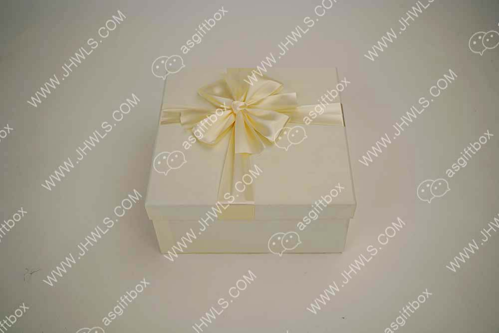 Ribbon-knotted gift box