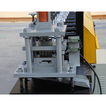 Roller shutter door forming machine with punching holes
