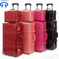 Vintage luggage red tie suitcase for women