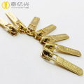 High quality debossed logo gold metal zipper slider