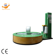 Non-woven paper roll pallet wrapping machine