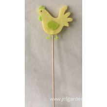 Little yellow chicken hanging holiday ornaments