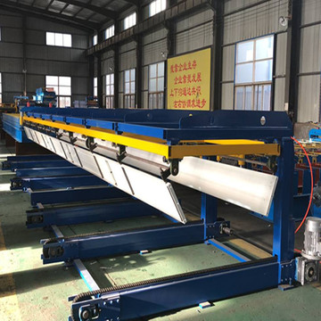 Automatic sheet stacker for roll forming machine