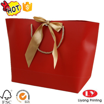 Paper packaging bag with logo print handles