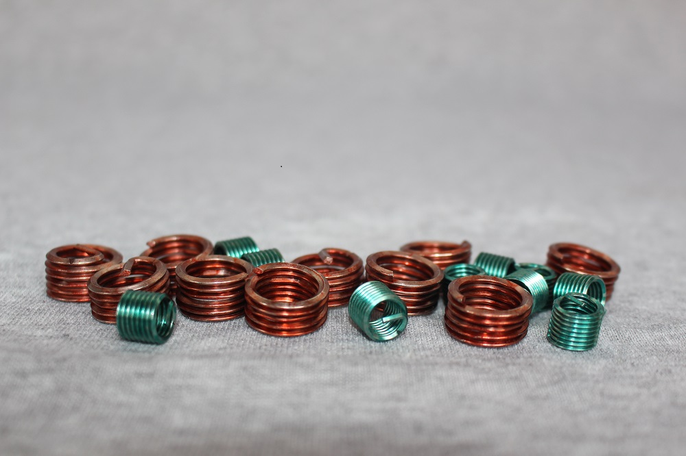 Coated thread insert