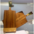 Paddle walnut wood chopping board with handle