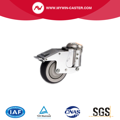 Spring shock absorbing caster with swivel brake