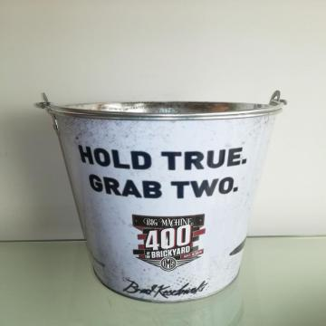 Metal tin bucket in home
