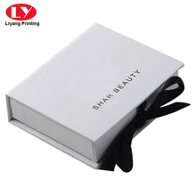 White rigid magnetic folding box ribbon closure