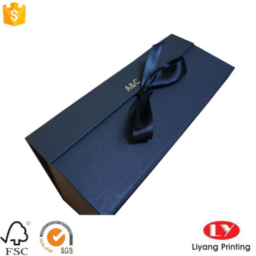 Magnetic foldable paper gift box with ribbon