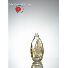 Round Shape Glass Bottle with Golden Decal