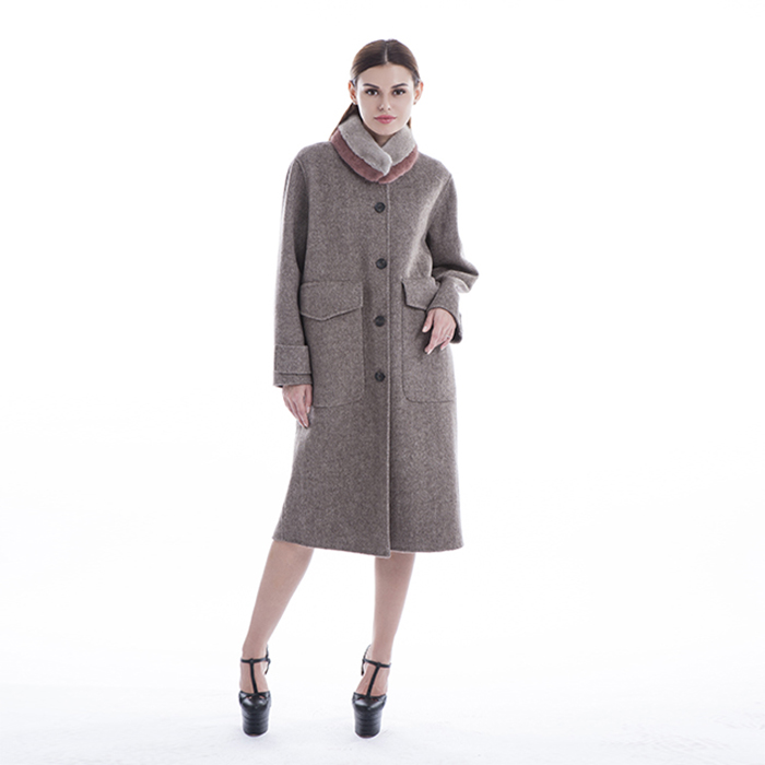 Sleeves of winter black and white checked cashmere overcoat