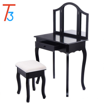 Bedroom with black dressing table with mirror and stool