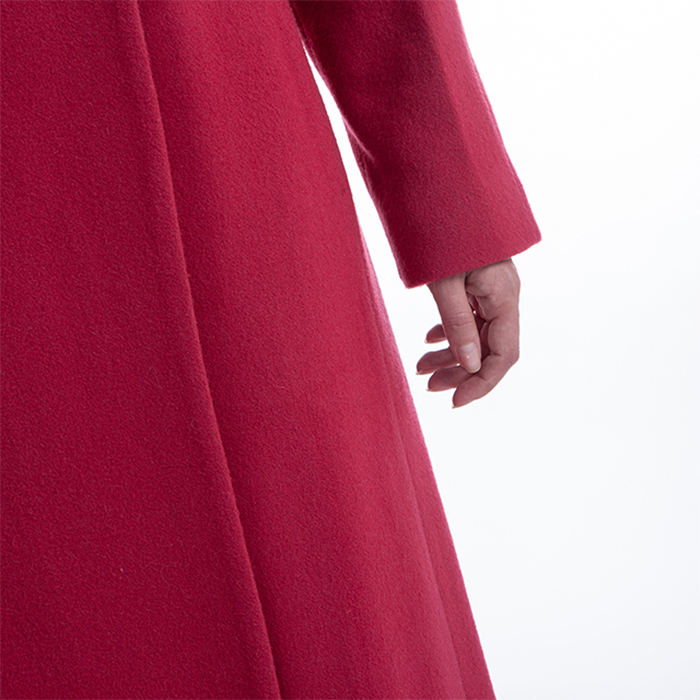The sleeves of the new red winter dress