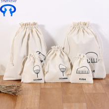 The canvas drawstring bag carries a beaded bag