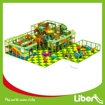 Indoor playground with slide barrier