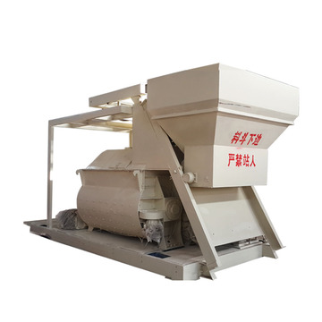 Low cost self loading concrete mixer with hopper