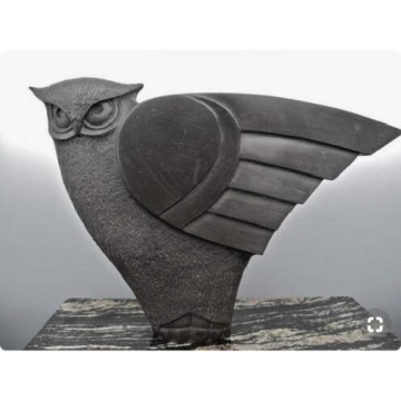 Black granite winged owl