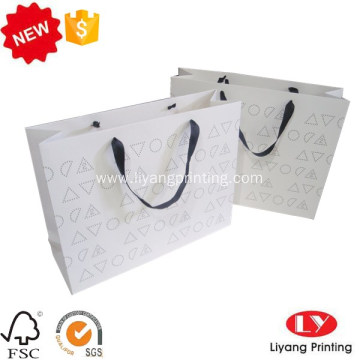 White shopping gift paper bag wih logo
