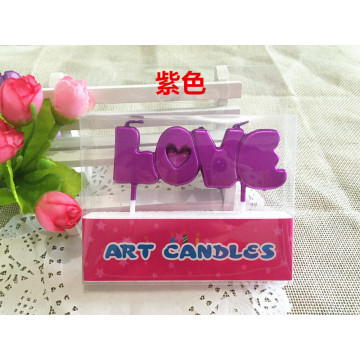 """Love"" letters shaped stick candles for valentine cake"
