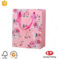 Exquisite paper gift bag with ribbon handle