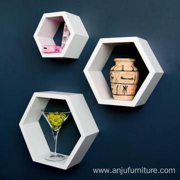Decorative shelves on hexagonal wooden wall