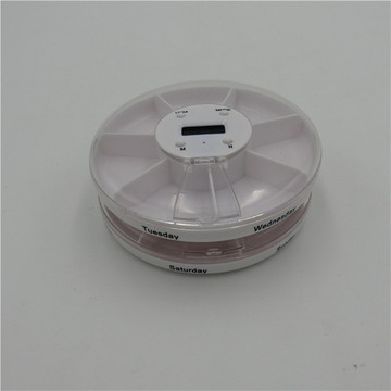 small round pill case with alarm