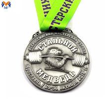 Metal award weightlifting games medal