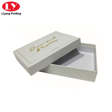 White cardboard gift box with gold stamping logo