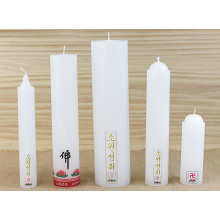 white buddhist pillar spiritual candles