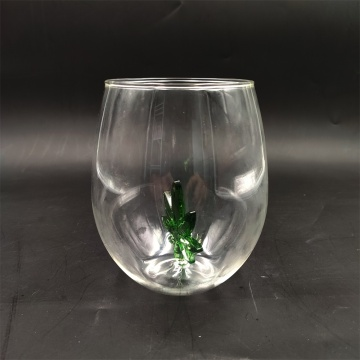Heat resistant wine glass with green tree inside
