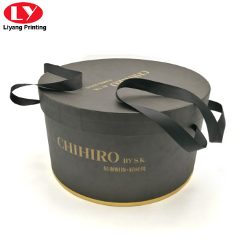 Large rigid round box with ribbon handle