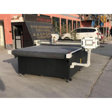 Oscillating knife cutting machine with loading system